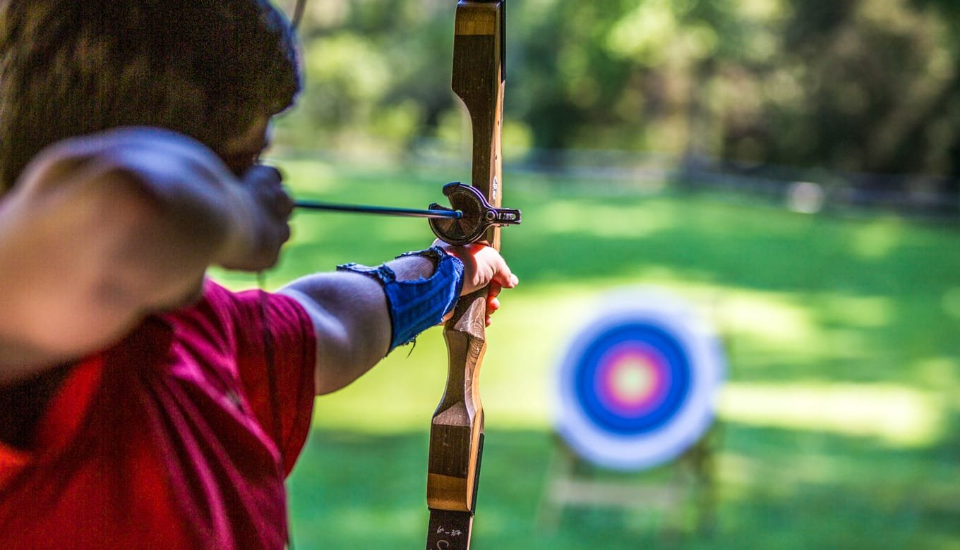 Boy shooting archery arrow