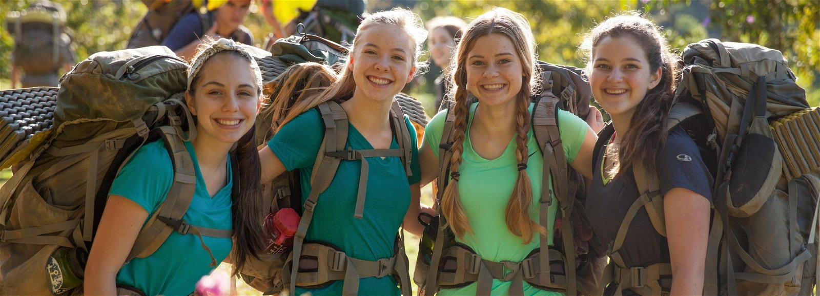 Four girls with backpacks on