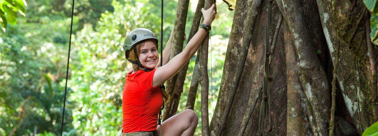 Girl climbing a tree in Bolivia