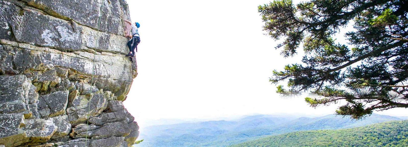 Teen climbing at the Durham Academy Senior Challenge