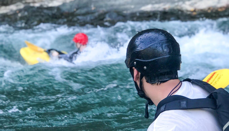 Kayak instructor and teen kayaker in white water