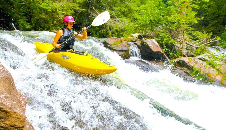 Female white water kayaking