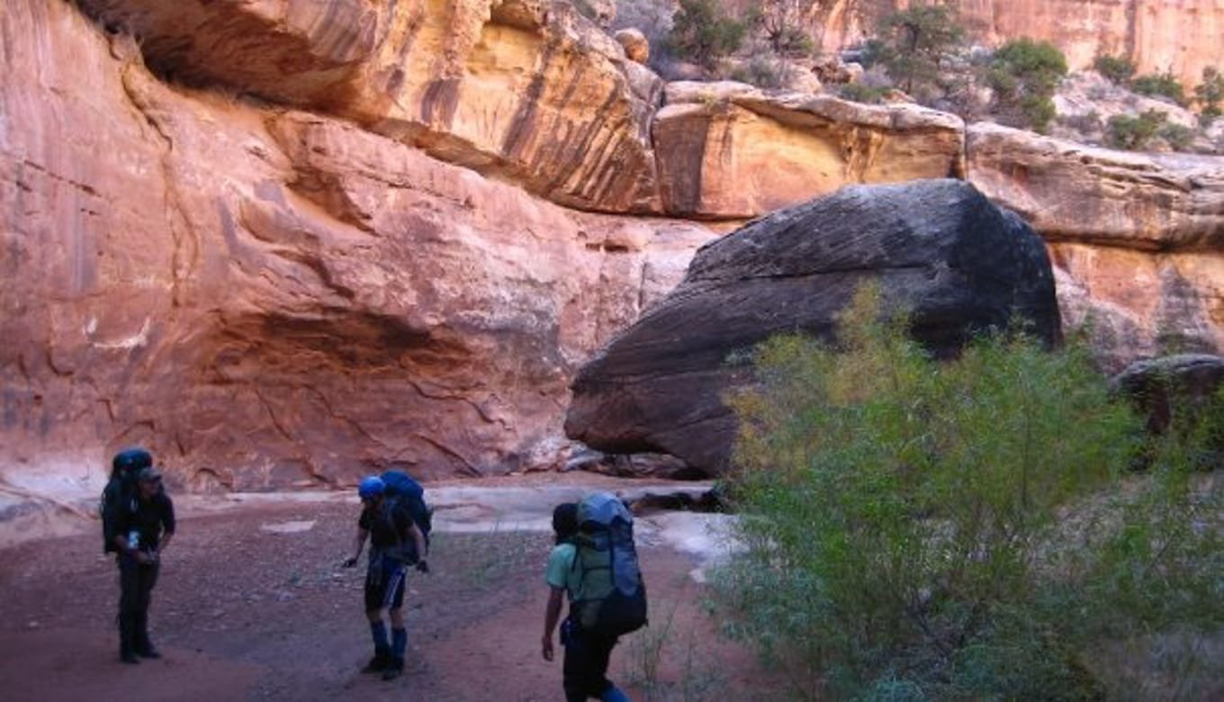 Teens hiking in canyon in Utah